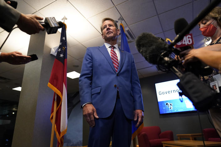 FILE - In this Aug. 26, 2021 file photo, Georgia Gov. Brian Kemp speaks during a news conference at Lockheed Martin in Marietta, Ga. The rewards of an early Donald Trump endorsement will be on display Saturday, Sept. 25 in Georgia. A three-man ticket of candidates he's backing in 2022 Republican primaries for statewide office will take the stage with him. (AP Photo/Brynn Anderson, File)