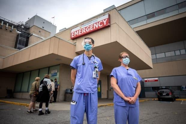 Dr. Paul Brown and nurse Abby Holder are pictured outside of the Royal Columbian hospital's emergency entrance in New Westminster last summer. There are now more patients in hospital with COVID-19 in B.C. than at any other point in the pandemic. (Ben Nelms/CBC - image credit)