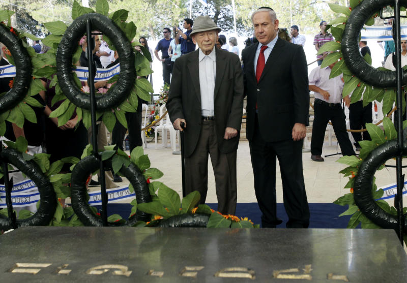 FILE - In this July 11, 2010 file photo  Israeli Prime Minister Benjamin Netanyahu, right, and his father Benzion attend the official memorial service for the late Zionist leader Ze'ev Jabotinsky at the Mt. Herzl cemetery in Jerusalem. Benzion Netanyahu, historian, Zionist activist and influential father of Israeli Prime Minister Benjamin Netanyahu, died Monday, April 30, 2012, in his Jerusalem home, the Israeli leader's office said. He was 102.  (AP Photo/Kobi Gideon, Pool, File)