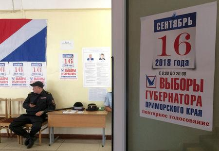 FILE PHOTO: A policeman guards a polling station during the gubernatorial election in Vladivostok