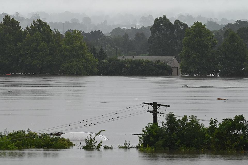 <p>Power lines are downed and a boat upturned in Richmond.</p>