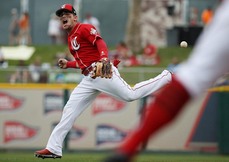 Cincinnati Red's All-Star Second Baseman Scooter Review suffered a freak injury during Friday's Cactus League game. (AP Photo / Ross D. Franklin)