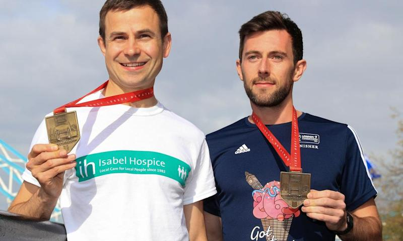 David Wyeth of Chorlton Runners with Swansea Harrier Matthew Rees, who helped Wyeth to the finishing line of the London Marathon on Sunday.