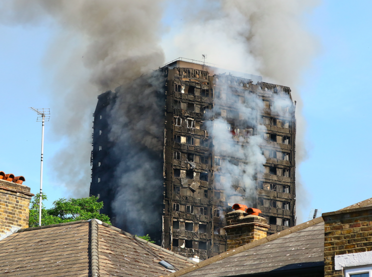 Smoke billows from the tower block on Wednesday morning