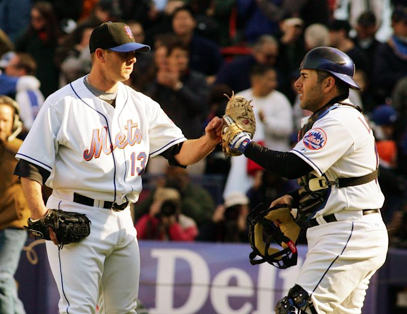 New York Mets pitcher Billy Wagner (13) is congratulated by catcher Paul Lo Duca after the Mets defeated the Philadelphia Phillies 11-5 in their baseball game, Monday, April 9, 2007 at Shea Stadium in New York. (AP Photo/Ed Betz)