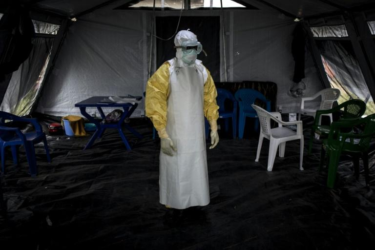 Suited up: A health worker gets ready to perform checks at an Ebola treatment centre in Beni