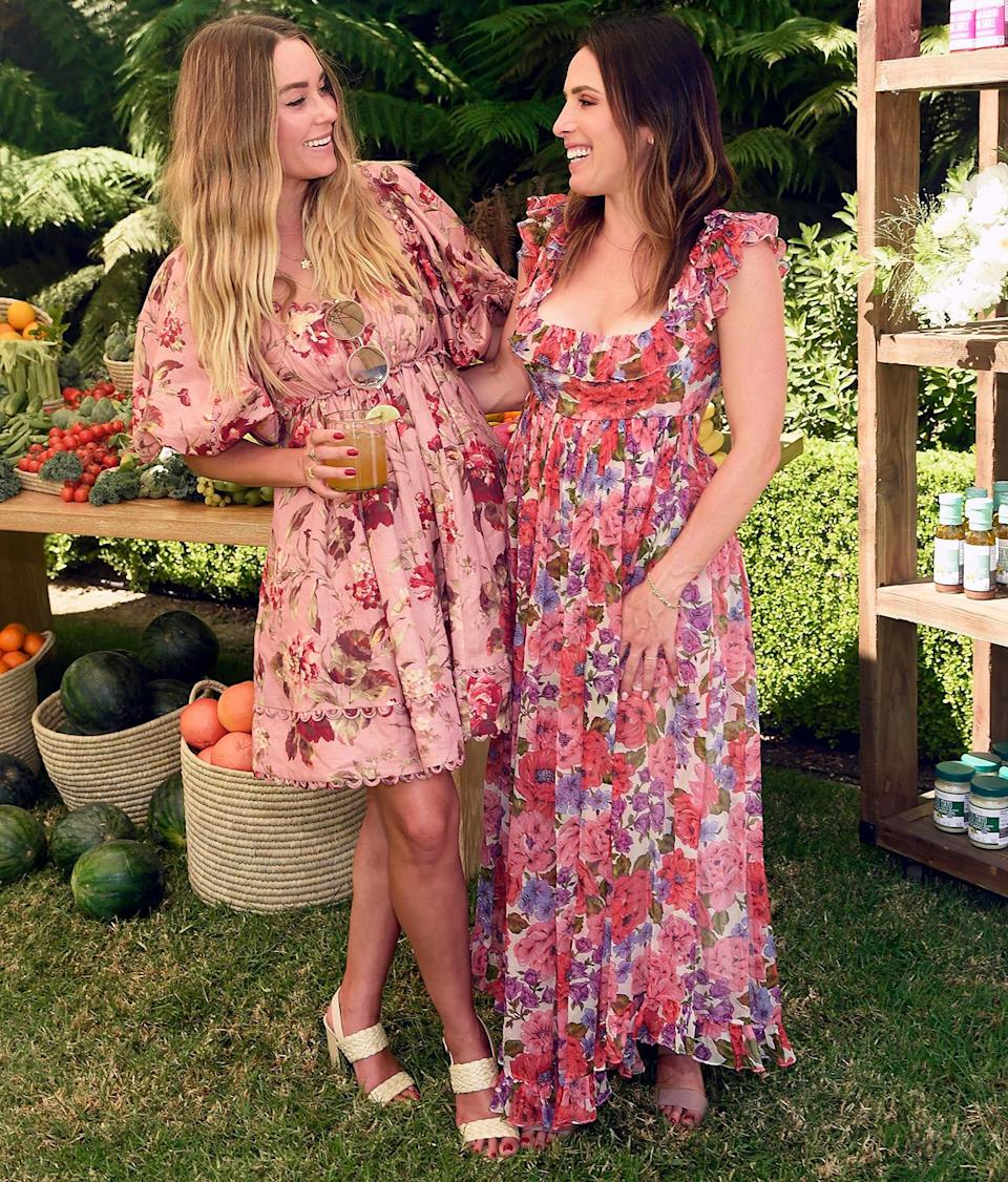 <p>Lauren Conrad enjoys a cocktail while posing with The Little Market co-founder Hannah Skvarla at the brand's summer event in Los Angeles on Aug. 27.</p>