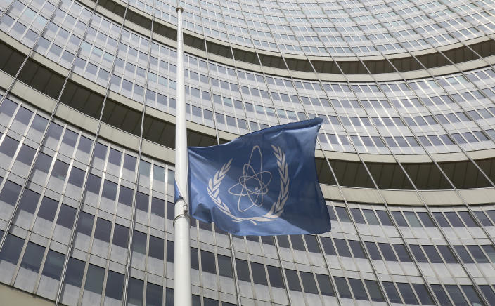 A flag is set to half mast in front of the International Atomic Energy Agency (IAEA) building in Vienna, Austria, Monday, July 22, 2019. The IAEA announced the death of the agency's Director General Yukiya Amano at the age of 72 years. (AP Photo/Ronald Zak)