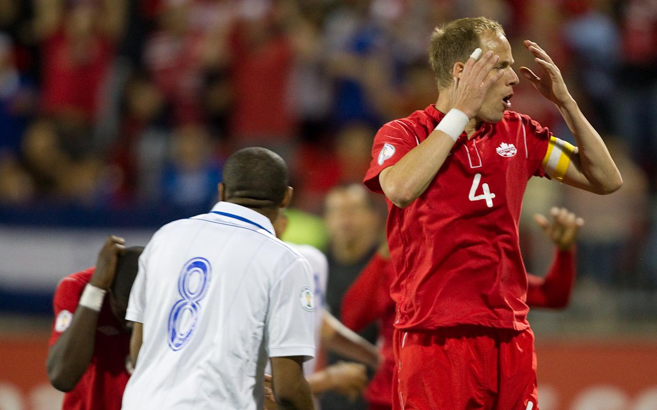 Kevin McKenna of Canada reacts after narrowly missing the goal with a header in the final seconds of Canada's FIFA 2014 World Cup Qualifier against Honduras at BMO field in Toronto, Ontario, June 12, 2012. The match ended in a 0-0 tie.  AFP PHOTO/Geoff RobinsGEOFF ROBINS/AFP/GettyImages