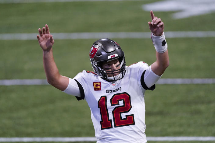 Tampa Bay Buccaneers quarterback Tom Brady (12) reacts after a Tampa Bay Buccaneers touchdown against the Atlanta Falcons during the second half of an NFL football game, Sunday, Dec. 20, 2020, in Atlanta. (AP Photo/John Bazemore)