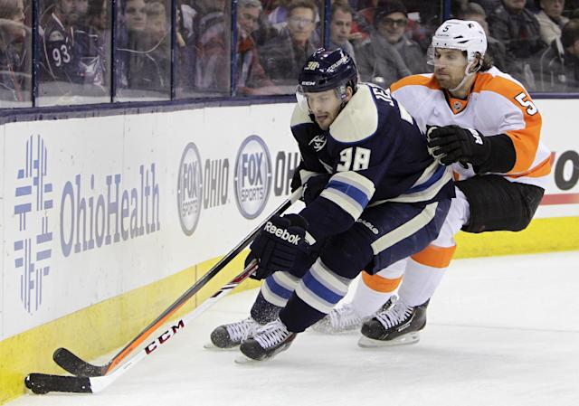 Columbus Blue Jackets' Boone Jenner, left, carries the puck as Philadelphia Flyers' Braydon Coburn defends during the second period of an NHL hockey game Thursday, Jan. 23, 2014, in Columbus, Ohio. (AP Photo/Jay LaPrete)