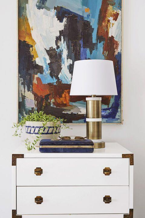 <p>Instead of a mirror, amp up the space above a neutral dresser with a large-scale piece of artwork. You can never go wrong with abstract art.</p>