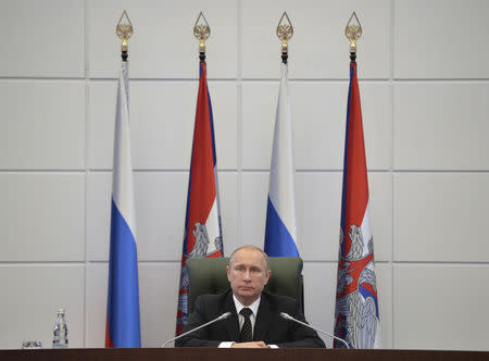 Russia's President Putin chairs a meeting with senior military officials at the Defense Ministry's control room in Moscow in Moscow
