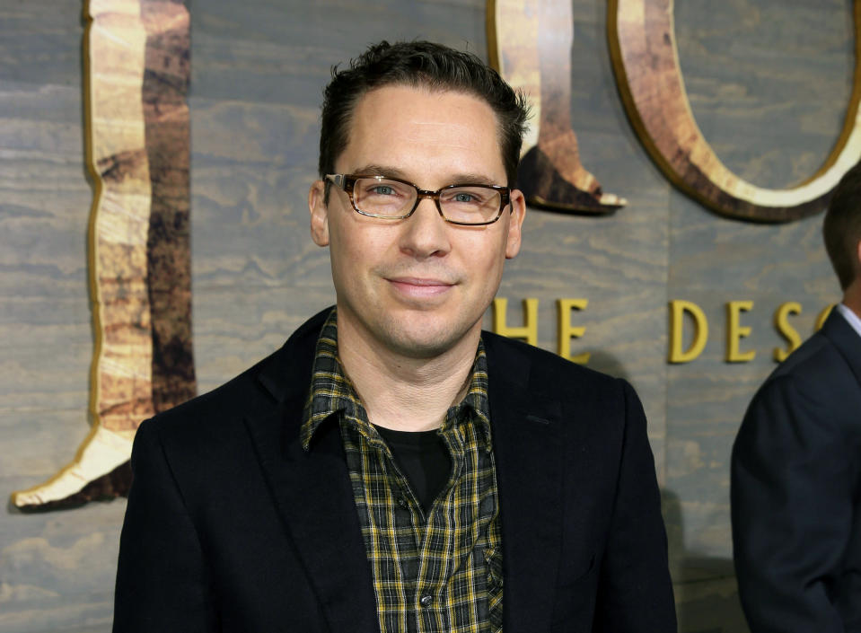 """FILE – This Dec. 2, 2013 file photo shows Bryan Singer at the Los Angeles premiere of """"The Hobbit: The Desolation of Smaug."""" (Photo by Matt Sayles/Invision/AP, File)"""