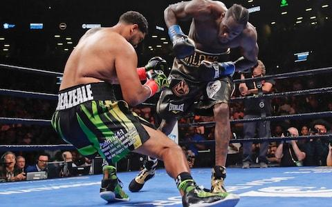 Deontay Wilder, right, knocks down Dominic Breazeale during the first round of the WBC heavyweight championship boxing match Saturday, May 18, 2019, in New York. - Credit: AP Photo/Frank Franklin II