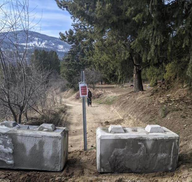 The regional district has set up cement barriers on the roads around Brilliant Flats.