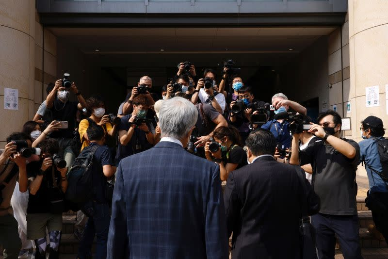 Democratic Party founder and barrister Martin Lee and Albert Ho arrive at the West Kowloon Courts for verdicts in landmark unlawful assembly case, in Hong Kong
