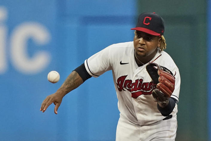 Cleveland Indians' Jose Ramirez fields a ball hit by Tampa Bay Rays' Ji-Man Choi, who was thrown out at first during the fifth inning of a baseball game Saturday, July 24, 2021, in Cleveland. (AP Photo/Tony Dejak)