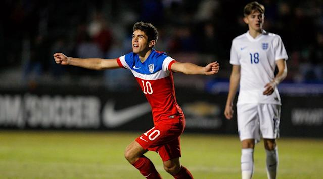 <p>Christian Pulisic of the USA celebrates his goal as William Patching of England reacts during the Nike International Friendlies at The Premier Sports Campus at Lakewood Ranch on Nov. 28, 2014 in Sarasota, Fla.</p>