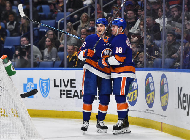 New York Islanders center Derick Brassard, left, celebrates his goal against the Buffalo Sabres with Anthony Beauvillier during the first period of an NHL hockey game in Buffalo, N.Y., Saturday, Nov. 2, 2019. (AP Photo/Adrian Kraus)