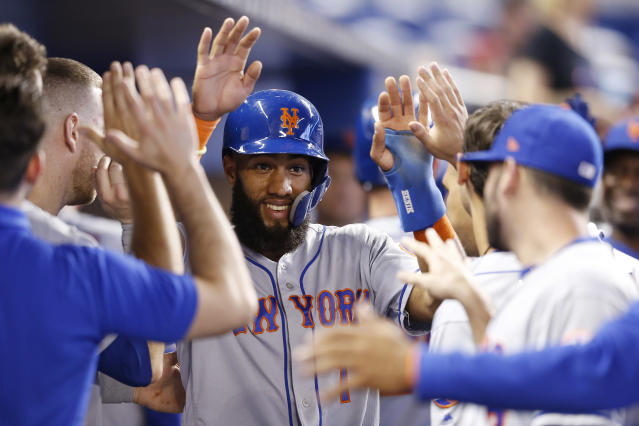 MIAMI, FLORIDA - JULY 14: Amed Rosario #1 of the New York Mets celebrates with teammates after scoring a run in the eighth inning against the Miami Marlins at Marlins Park on July 14, 2019 in Miami, Florida. (Photo by Michael Reaves/Getty Images)