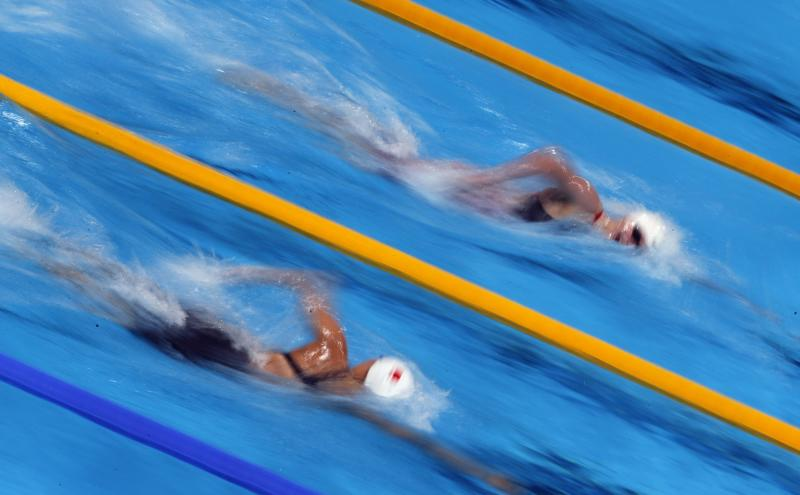 United States's Katie Ledecky, top, and China's Shao Yiwen compete in a heat of the Women's 400m freestyle at the FINA Swimming World Championships in Barcelona, Spain, Sunday, July 28, 2013. (AP Photo/Emilio Morenatti)