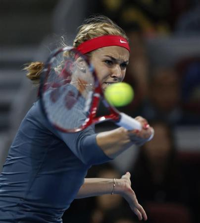 Sabine Lisicki of Germany returns a shot against Li Na of China during their match at the China Open tennis tournament in Beijing October 2, 2013. REUTERS/Kim Kyung-Hoon