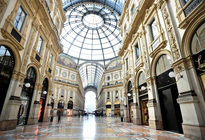 People walk in Galleria Vittorio Emanuele II, after the Italian government imposed a virtual lockdown on the north of the country, in Milan, Italy March 8, 2020. REUTERS/Flavio Lo Scalzo