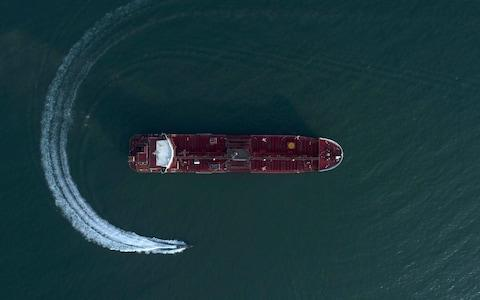 <span>An aerial view shows a speedboat of Iran's Revolutionary Guard moving around the British-flagged oil tanker Stena Impero, which was seized in the Strait of Hormuz </span> <span>Credit: AP </span>