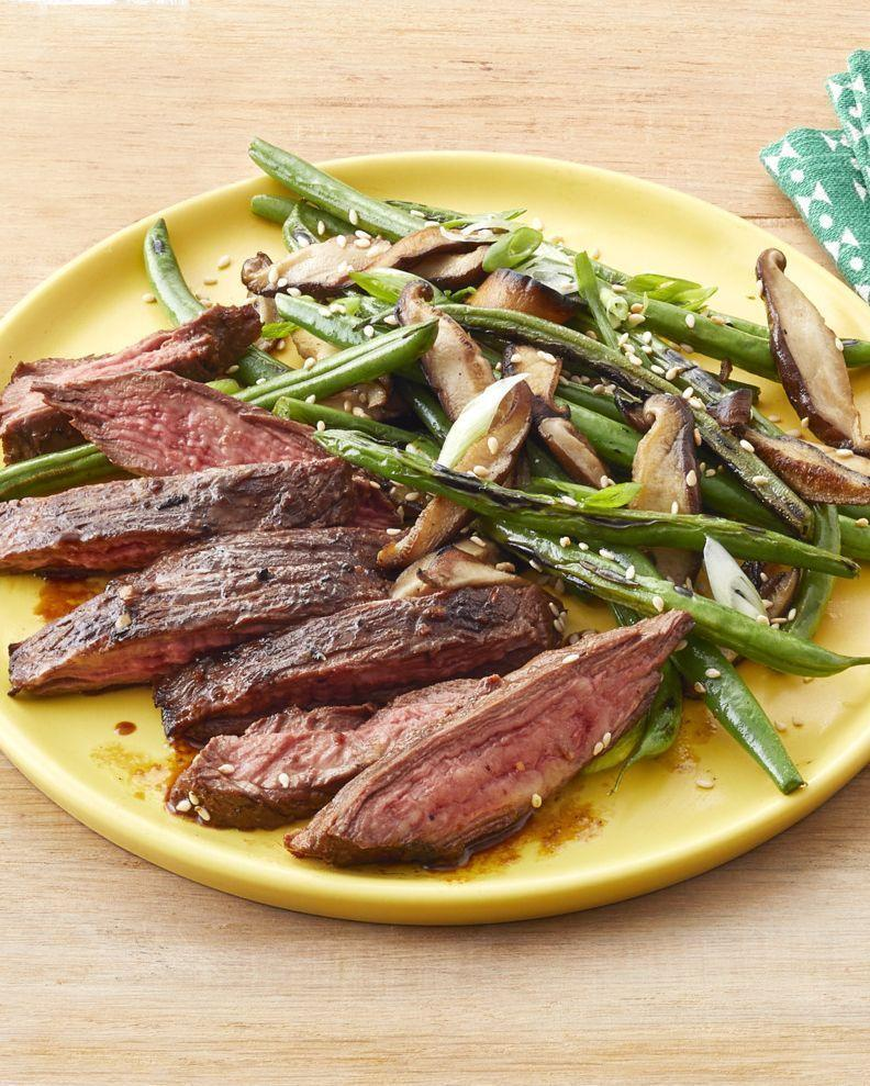 """<p>A quick marinade makes this steak the perfect weeknight meal. It's also extra flavorful, thanks to a mix of olive oil and butter.</p><p><strong><a href=""""https://www.thepioneerwoman.com/food-cooking/recipes/a32577477/skirt-steak-with-blistered-green-beans-recipe/"""" rel=""""nofollow noopener"""" target=""""_blank"""" data-ylk=""""slk:Get the recipe"""" class=""""link rapid-noclick-resp"""">Get the recipe</a>.</strong></p><p><a class=""""link rapid-noclick-resp"""" href=""""https://go.redirectingat.com?id=74968X1596630&url=https%3A%2F%2Fwww.walmart.com%2Fbrowse%2Fhome%2Fthe-pioneer-woman-dishes%2F4044_623679_639999_7373615&sref=https%3A%2F%2Fwww.thepioneerwoman.com%2Ffood-cooking%2Fmeals-menus%2Fg35191871%2Fsteak-dinner-recipes%2F"""" rel=""""nofollow noopener"""" target=""""_blank"""" data-ylk=""""slk:SHOP DISHES"""">SHOP DISHES</a></p>"""