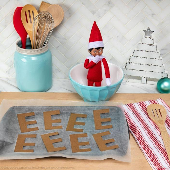"""<p>Punny ideas for the win! This crafty joke is so silly, even your Elf is bound to get a good laugh out of it. </p><p><strong>Get the tutorial at <a href=""""https://elfontheshelf.com/elf-ideas/baking-brown-es/"""" rel=""""nofollow noopener"""" target=""""_blank"""" data-ylk=""""slk:Elf on the Shelf"""" class=""""link rapid-noclick-resp"""">Elf on the Shelf</a>.</strong> </p>"""