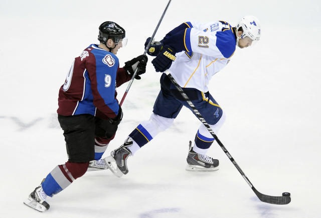 Colorado Avalanche center Matt Duchene, left, tries to catch St. Louis Blues center Patrik Berglund, right, in the first period of an NHL hockey game on Saturday, March 8, 2014, in Denver. (AP Photo/Chris Schneider)