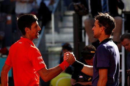 Tennis - ATP 1000 - Madrid Open - The Caja Magica, Madrid, Spain - May 11, 2019 Serbia's Novak Djokovic shakes hands with Austria's Dominic Thiem after their semi final match REUTERS/Susana Vera
