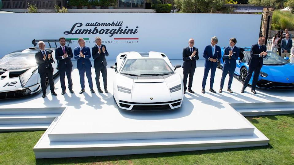 Andrea Baldi (right side, third from car) and members of the Lamborghini executive team reveal the new Countach at the Quail, a Motorsports Gathering last month. - Credit: Photo: Courtesy of Automobili Lamborghini S.p.A.
