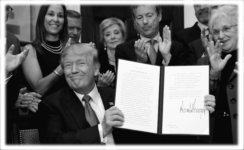 President Trump after signing an executive order in October 2017. (Photo: Kevin Lamarque/Reuters; digitally enhanced by Yahoo News)