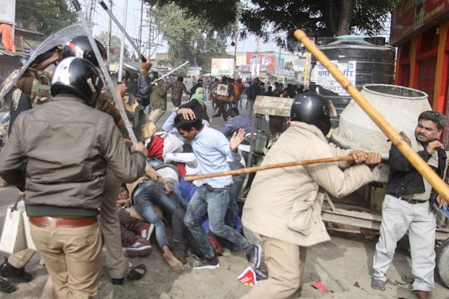 In this photo taken on December 19, 2019 police beat protesters with sticks during a demonstration against India's new citizenship law in Lucknow. - Indians defied bans on assembly on December 19 in cities nationwide as anger swells against a citizenship law seen as discriminatory against Muslims, following days of protests, clashes and riots that have left six dead. (Photo by STR / AFP) (Photo by STR/AFP via Getty Images)