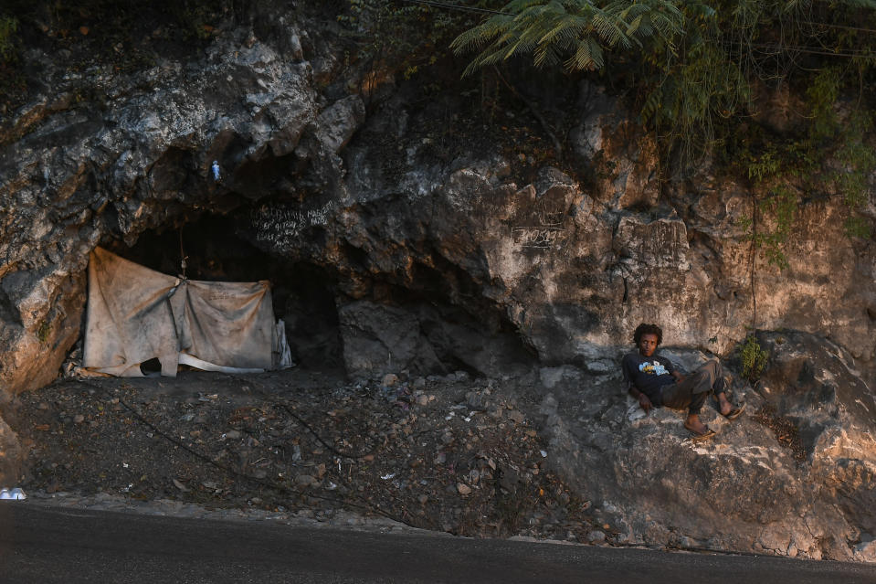 A person lies next to their tent along a street in Port-au-Prince, Haiti, Saturday, July 17, 2021. The country of more than 11 million people are still reeling from the July 7 killing of President Jovenel Moïse. (AP Photo/Matias Delacroix)