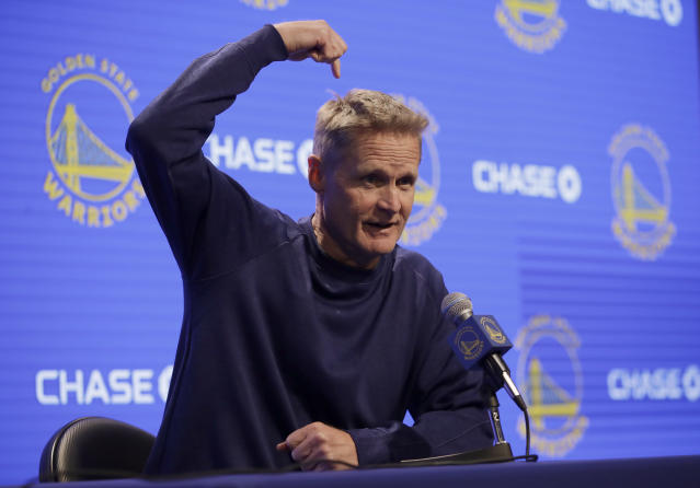 "Steve Kerr joked about riding a tricycle and wearing a propellor cap to his press conference after being called a ""little boy."" (AP Photo)"