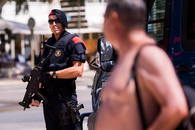 <p>A police officer patrols on the spot where five terrorists were shot by police on Aug. 18, 2017 in Cambrils, Spain. (Photo: Alex Caparros/Getty Images) </p>