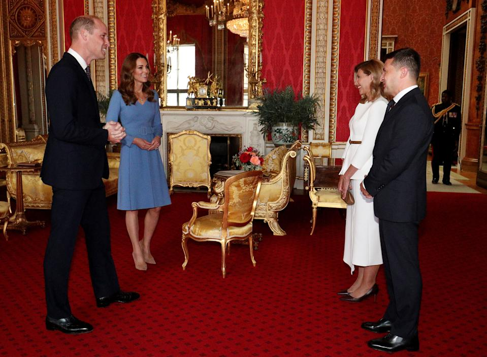 Britain's Prince William, Duke of Cambridge (L), his wife Britain's Catherine, Duchess of Cambridge (2L) talk with Ukraine's President Volodymyr Zelensky (R) and his wife Olena, during an audience at Buckingham Palace in central London on October 7, 2020. (Photo by Jonathan Brady / POOL / AFP) (Photo by JONATHAN BRADY/POOL/AFP via Getty Images)