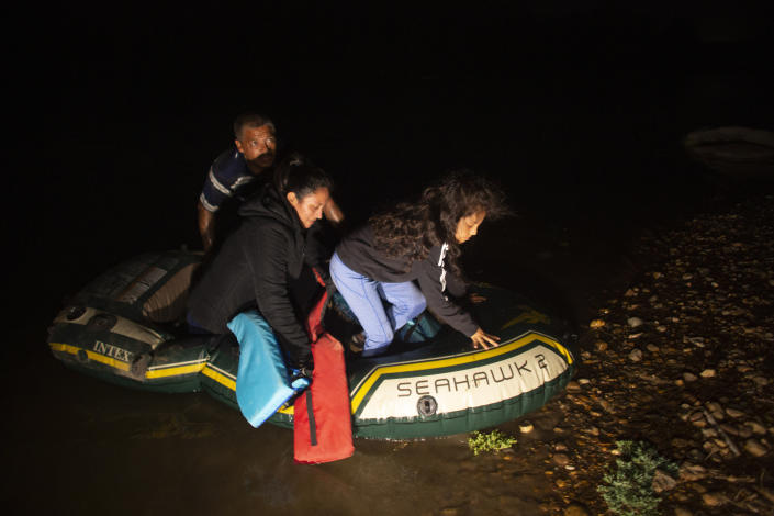 FILE - In this March 24, 2021, file photo, unaccompanied minor Kaylee Samantha, 7, who said she came alone from Mexico, gets off of a small inflatable raft onto U.S. soil after being delivered by a smuggler in Roma, Texas. She said she is trying to reach relatives in the U.S. Confronted with a stream of unaccompanied children crossing the border from Mexico, the U.S. government has awarded shelter-construction and management contracts to private companies that critics say may not be equipped to adequately care for the minors. (AP Photo/Dario Lopez-Mills, File)