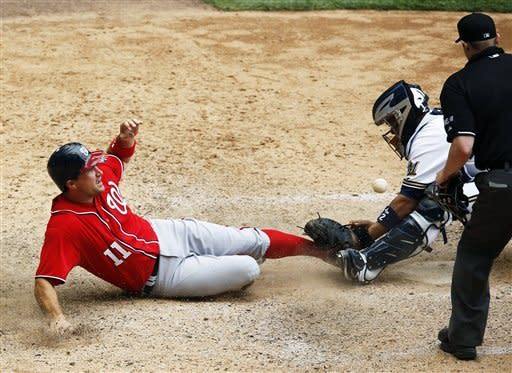 Washington Nationals' Ryan Zimmerman is safe at home as Milwaukee Brewers catcher Martin Maldonado drops the ball in the 11th inning of a baseball game, Sunday, July 29, 2012, in Milwaukee. (AP Photo/Tom Lynn)
