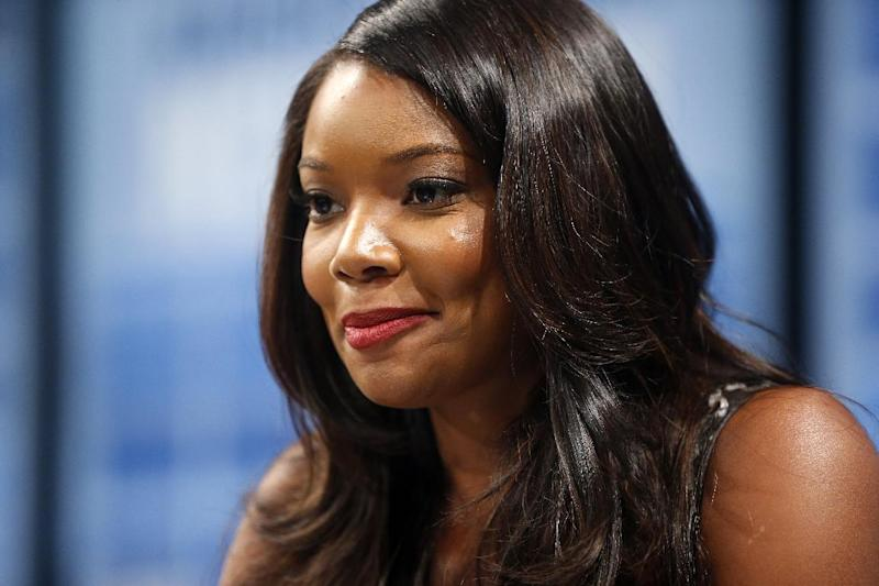 Actress Gabrielle Union is interviewed by the Associated Press, at the Newseum in Washington, Friday, Aug. 23, 2013, after the unveiling of a U.S. Postal Service stamp commemorating the 50th anniversary of the March on Washington. (AP Photo/Charles Dharapak)