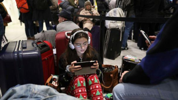 Passengers at Gatwick airport settle down to wait for their flights following the delays and cancellations brought on by drone sightings near the airfield, in London, Friday Dec. 21, 2018. New drone sightings Friday caused fresh chaos for holiday tra (The Associated Press)