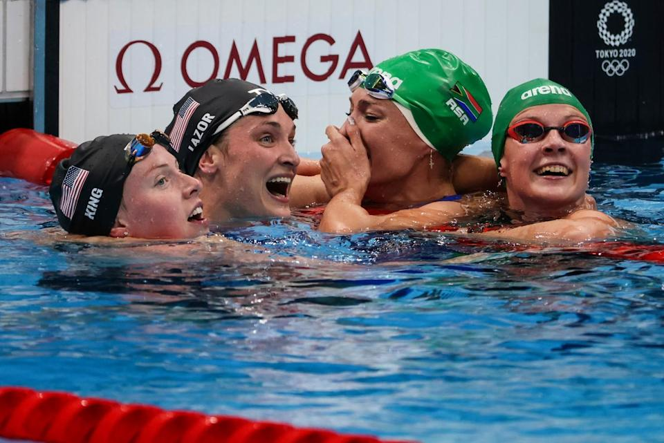 South Africa's Tatjana Schoenmaker is congratulated by teammate Kaylene Corbet, Lilly King and Annie Lazor.