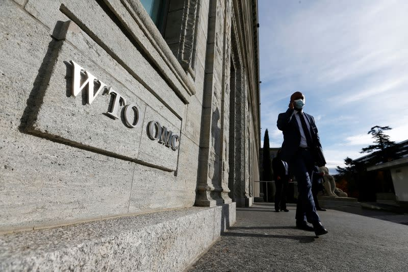 A delegate arrives before a meeting at the World Trade Organization (WTO) in Geneva