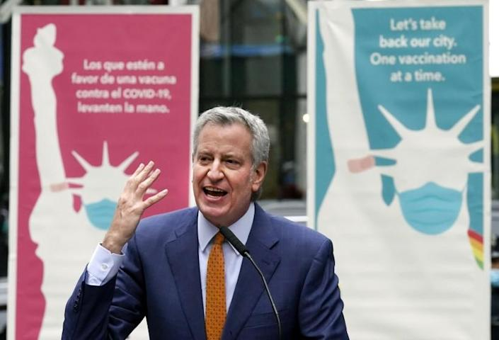 """FILE - In this Monday, April 12, 2021 file photo, New York Mayor Bill de Blasio delivers remarks in Times Square after he toured the grand opening of a Broadway COVID-19 vaccination site intended to jump-start the city's entertainment industry, in New York. Blasio expects the city to """"fully reopen"""" by July 1, with the lifting of the city's COVID-19 restrictions. He told MSNBC the city will be ready for stores, offices and theaters to open at full strength. He cited improved COVID-19 vaccination rates and decreasing hospitalization rates. (AP Photo/Richard Drew, File)"""