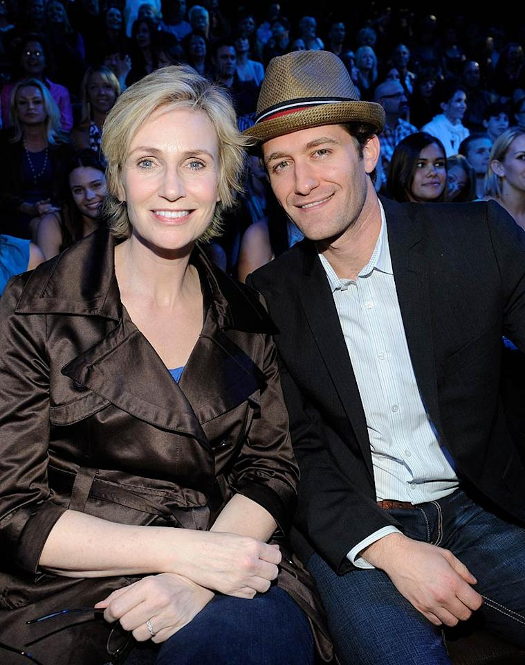 "One star who's lucky in love? ""Glee's"" Jane Lynch, who announced over the weekend that she was engaged to her longtime girlfriend, psychologist Lara Embry. Lynch sported her new ring while enjoying the tunes at ""American Idol's"" Elvis night with co-star Matthew Morrison on Tuesday. F Micelotta/American Idol 2010/Getty Images for Fox"