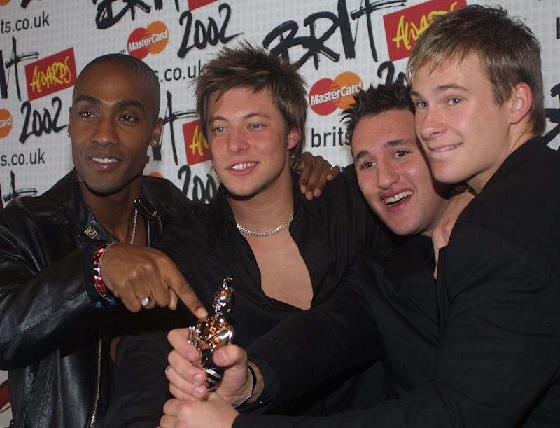 Best British newcomer band 'Blue' meets the media with their Brit Awards 2002 backstage at the event in London. The Brit Awards are the most important in Britain's music calendar. Blue are from the left, Simon Webbe, Duncan James, Antony Costa and Lee Ryan. (Photo by PA Images via Getty Images)