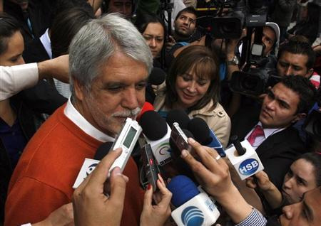 Green Party candidate for mayor of Bogota, Enrique Penalosa, speaks to the media at a school in Bogota